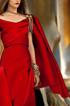 Chanel dress with a golden lion brooch to keep the cape in place, for Cersei Lannister.