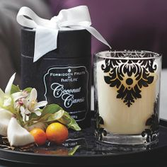 "Sensual and sophisticated Coconut Caress fragrance fills our elegant damask patterned glass jar. Creamy, rich coconut touched with pineapple wraps you in the warmth of a tropical embrace. Ready for giving in a beribboned black box. Burn time: 45-55 hours. 3¾""h.  #ForbiddenFruits #Partylite  #Candles"