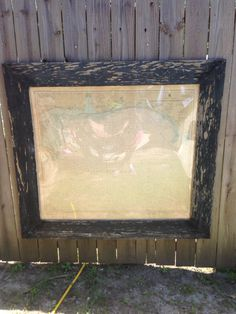 Old black chippy paint wooden framed map