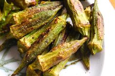 Okra, olive oil, salt, pepper - tossed together, layered on foil lined cookie sheet and put into a 425 F oven for 10 - 15 minutes. (Paprika, Lemon Juice, Onion Salt, Cumin and more optional).
