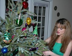 Me, last Christmas. Love real Christmas trees. The scent brings back childhood memories. But I plant a tee in my backyard in replacement of the tree nature lost. -Mari