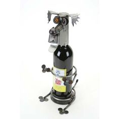 Golden Retriever Wine Holder Yardbirds by Richard Kolb by Yardbirds Richard Kolb. $88.00. Golden Retriever Wine Holder Yardbirds by Richard Kolb. Wine Bottle Holder, Jason the Golden Retriever Bandana Yardbirds  Each Yardbird Wine Bottle Holder is created with scrap and recycled parts. Unique & Whimsical they're perfect to hold a bottle of wine, and excellent to give to the person that has everything. Due to the handcrafted nature of these pieces, no two are ever exactly alike. C...