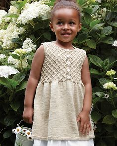 This pretty-as-a-picture lattice-yoke dress is ready for a garden party or Easter egg hunt. The button front does more than just flatter—it makes the garment easy for little girls to put on. The yarn is Eco Baby, a 100% organic, Fair Trade-sourced cotton dyed with colorants that are as gentle on the little ones' skin as they are to the Earth.
