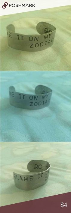 Blame it on my zodiac sign bracelet Silver colored bracelet with black letters. Never worn Jewelry Bracelets