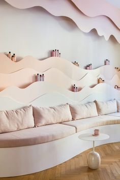 Much of the furniture was specially designed for the project, including product shelves, sofas and a beauty bar made from wood and MDF. Pastel Colour Palette, Pastel Colors, Colours, New Interior Design, French Interior, Cool Swings, Maria Nila, Hair Salon Interior, Ceiling Installation