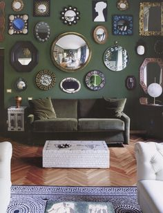 mirror gallery on green wall, Fornasetti family home, Milan