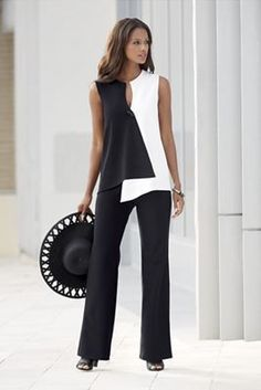 Opposites Attract Pant Suit from Monroe and Main. Dramatic geometrics curve and contour your shape into ultra-modern flattery. Crossover style top has toggle closure.