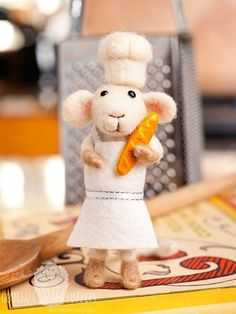 Chauncy the Chef - Handcrafted, needle felted collectible. Chauncy comes with a baguette, a needle felted chef's hat and a white wool felt apron with white ribbon trim! He's the perfect addition to your kitchen all year round!