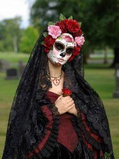 Headpiece with veil, creepy makeup.