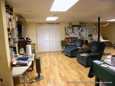 view straight in as you walk in from the garage. I have an ironing board that does double duty as a glue & paint station with supplies on a small shelf behind it. The 2 recliners are moved in front of the closet doors and I put up 2 folding tables to teach scrap classes & hold workshops.
