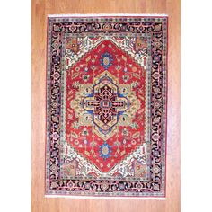 With a distinctive style, this beautiful Indian area rug will lend a touch of splendor to any decor. This gorgeous Heriz area rug is hand-knotted with a geometric pattern in shades of red, black, ivory, green, grey, salmon pink, gold and light blue.