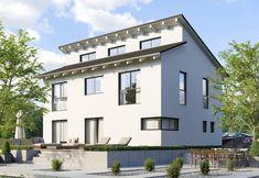 Fertighaus Düsseldorf gesamtansicht beleuchtet mit terasse efh einfamilienhaus haus p in