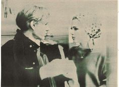 Andy warhol and Edie sedgwick march 1966 at a boutique openining. With the velvet underground&nico