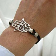 hamsa (the hand) protects you from evil and has been around for thousands of years... still cool