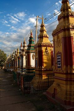 Stupas in a Line at Vat Tham Fai temple in Pakse, Laos (by Nataraj Metz).