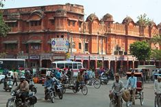 Street scene in Jaipur, Rajasthan, India, with some of the city's historic rose-coloured buildings in the background. Jaipur India, Painting Inspiration, Asia, Street View, History, City, World, Places, Image