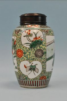"""Yellow and green jar with prunis, and panels with figures. Wooden cover. 8"""" in height. Tung-Chih 1862-1874."""