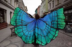 Dorota Drzewiecka wants you to float like a butterfly with her collection of ethereal, hand-painted scarves. The oversized silk pieces flutter and flow thr
