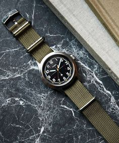 Inspired by military-spec watches and reinvented for everyday civilian wear, the latest collaboration between Todd Snyder and Timex reflects a shared commitment to design, utility and craftsmanship. Timex Military Watch, Todd Snyder Timex, Watches Photography, Timex Watches, Women's Watches, Luxury Watches, Swiss Army Watches, Beard Styles For Men, Nato Strap