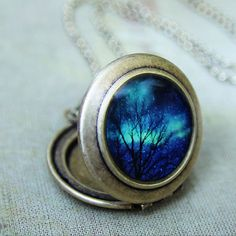 """""""Stars in Space"""" Photo Locket -   Image is of the Winter Aurora Borealis over Northern Quebec..."""