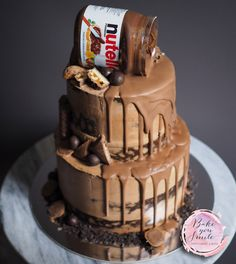 Yummy Nutella drip cake. Layered semi naked cake topped with chocolate bar pieces and a jar of Nutella - perfect for corporate events, birthdays or wedding celebrations. By Bake you smile in Perth, Australia