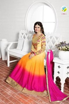 Attractive , Prachi Desai long anarkali style dress in yellow and rani color Georgette .
