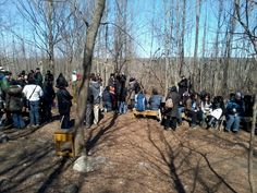 Scene of some people gathered at a healing session at Marmora, Ontario, Canada