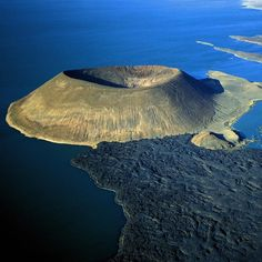 #Kenya Lake Turkana  #Nabuyatom volcano  This photo is part of #EpicoVolcano our work devoted to the power of Volcanoes. Click on the hashtag to see other photos from this serie.  Do you like our photos? Help us to growth: follow us!  #travel #tourism #travelling #traveling #travelgram #traveler #travelphotography #travels #traveltheworld #travelphoto #traveldiaries #travelingram #travelpics #tour #tourist #tourists #nature #volcano #outdoor #adventurephotography #aerialphotography #drones…