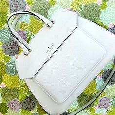 Kate Spade Aubrey Boxwood Road White purse Beautiful bag, trapazoid like shape pebbled leather,gold tone hardware two handles & strap for crossbody.  Zipper closure  one front pocket with flap and magnet closure  Interior features 1 zip pocket 2 open pocket Tag says cream color but looks more white  10 H x 12 w x 5.5 D kate spade Bags Satchels