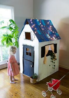 Create a magical space for kids to play and fuel their imagination with their very own cardboard playhouse! Using some cardboard and a little bit of paint, find out how you can build your own fort for kids with a step-by-step tutorial from Say Yes. Cardboard Playhouse, Build A Playhouse, Cardboard Crafts, Cardboard Furniture, Playhouse Ideas, Cardboard Design, Painted Playhouse, Cardboard Box Houses, Cardboard Castle