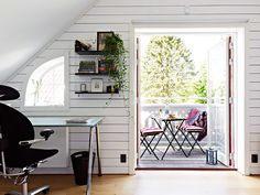 Incredible attic workspace in Sweden. There's just something spectacular about easy access to the outdoors from your desk. With this picture I can just envision myself taking small breaks for fresh air and dreaming, then returning to my desk to execute.