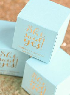 """Blue & Gold """"She Said Yes"""" Engagement Party Ideas: Cute favor boxes to fill with candy or other treats"""