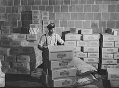 Worker loading sugar into a Washington, D.C. grocery store in July 1942.