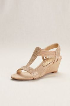 """Outdoor ceremonies and tented receptions call for a shoe that's pretty and practical. Enter these dressy wedges with glittery studded straps designed with elastic for a comfortable fit.  New York Transit  Synthetic  2 1/2"""" heel  Imported  Fits true to size"""