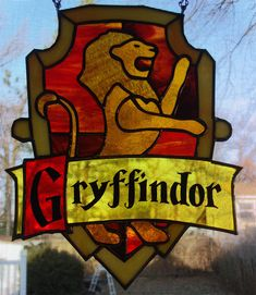 Griffyndor from Harry Potter by grandapok.deviantart. The letters are painted on the back with acrylic.