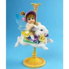 Spring Carousel Fairy www.teeliesfairygarden.com When flowers are in bloom every spring, this magical bunny carousel will appear and lets every fairy ride on it.  Certainly, the fairies would be delighted to hop for a ride! #carouselfairy