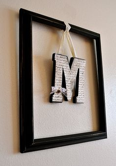 Who knew picture frames could be so charming? Dangling your initials - or baby's initial - adds for a modern twist on home decor. Framed Letters, Hanging Letters, Diy Hanging, Decorative Letters For Wall, Hanging Decorations, Large Letters, Diy Monogram, Framed Monogram, Initial Wall
