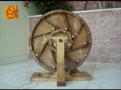 Bhāskara's wheel was invented in 1150 by Bhāskara II, an Indian mathematician, in an attempt to create a hypothetical perpetual motion machine. Energy Projects, Projects To Try, Mobiles, Marble Machine, Mobile Sculpture, Perpetual Motion, Alternative Energy, Heating And Cooling, Art And Technology