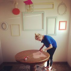 Painted garage sale frames. coral table.