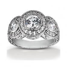 Platinum Halo 3 Stone Engagement Ring with Milgrain Edges and Antique Side Detailing available at Wheat Jewelers
