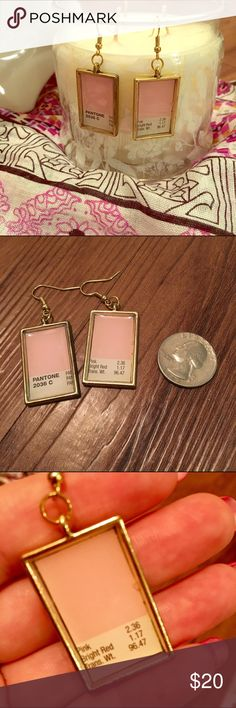 Unique light pink Pantone search drop earrings I made these as an experiment for my Etsy store, and they didn't turn out perfectly so I'm posting them at a discount here instead. The recycled Pantone swatch is a very light baby pink, the earrings themselves are gold tone. High quality materials. The imperfection is a bubble in the resin of the 2nd earring. You can see it in the last pic (far right side near center). Not noticeable when you're wearing them, but can't sell them in my shop with…