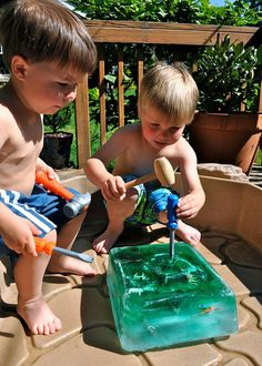 How to keep a child busy for hours in the summer: DIY: Giant Ice Cube Awesomeness - filled with plastic animals, dinos, and such. Make it a learning experience by talking about the ice age first :-)