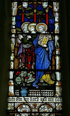 St Thomas The Apostle Church, stained glass window. On the island of Harty, which has since been united with the fellow island of Sheppey (in Kent), the tiny church apparently originated but was also brought into disrepair in Saxon times. It was rebuilt by the Normans and broadened through time. Though it was damaged in World War II, it appears intact and retains its pews, old window designs, etc. Photograph (May 23, 2007) by barryslemmings, Flickr.