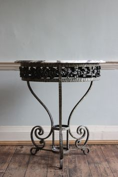 Absolutely gorgeous little 1920s French wrought iron and marble top table available on the Decorative Collective website from member Brownrigg