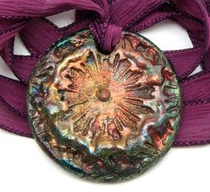 Raku medallion by MAKUstudio