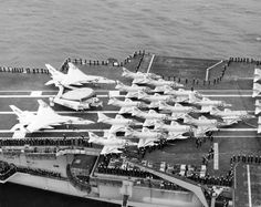 """View of the aft flight deck of the U.S. Navy aircraft carrier USS Enterprise (CVAN-65) in San Francisco Bay on 21 June 1966, returning from her first Vietnam cruise. Visible are 15 Douglas A-4C Skyhawks from Attack Squadrons VA-36 Roadrunners, VA-76 Spirits and VA-94 Shrikes. There is actually no aircraft visible from CVW-9's fourth A-4C Squadron VA-93 Blue Blazers, just the sign reading """"VA-93 Blue Booze"""