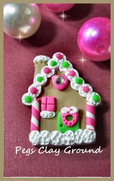 Taking orders for Gingerbread house pendants and bow centers.  Message me through etsy. Thanks! Polymer Clay Gingerbread House clay Pendant Bow by PegsSewCrafty