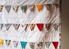 Hanging White Quilt with Patterned Triangle Details