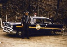 historicaltimes:  Kentucky State Police trooper posing with his Chevrolet Bel Air. 1950s