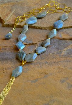 """Labradorite, 14 kt gold-filled beads and chain with gold tassel. Necklace is approximately 32"""" in length, with a 3"""" extender. Coordinating bracelet and earrings sold separately. Stones may vary slight"""